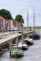 Sail boats, yachts and riverfront houses in Skibbroen by Ribe River in medieval Ribe centre, South Jutland, Denmark