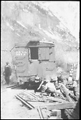 A group of workmen is re-railing D&amp;RG box car #3279 at MP 47 on the RGS Telluride Branch just west of Pandora.  Same or better image at RD130-011.<br /> RGS  Pandora, CO  Taken by Engel, Charles Miller - ca. 1920