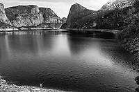 A fisherman has the entire  Hetch Hetchy reservior to himself and quite a view to go with it