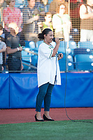 A local singer performs the National Anthem before a Northwest League game against the Salem-Keizer Volcanoes at Ron Tonkin Field on September 1, 2018 in Hillsboro, Oregon. The Salem-Keizer Volcanoes defeated the Hillsboro Hops by a score of 3-1. (Zachary Lucy/Four Seam Images)