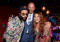 """LOS ANGELES, CA - APRIL 3: (L-R) Cast member Desmin Borges, Creator/EP/Showrunner/Writer/Director Stephen Falk and cast member Kether Donohue attend the post-party at Two Bit Circus following the FYC Red Carpet event for the series finale of FX's """"You're the Worst"""" on April 3, 2019 in Los Angeles, California. (Photo by Frank Micelotta/FX/PictureGroup)"""