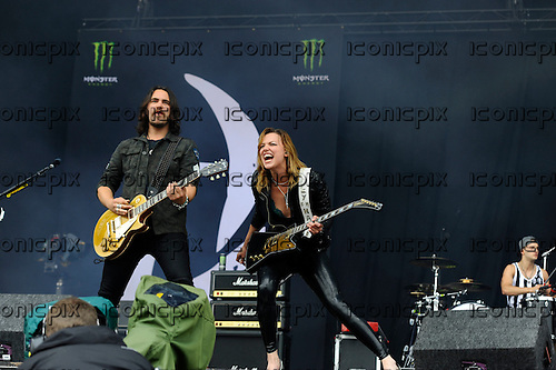 HALESTORM - guitarist Joe Hottinger and vocalist Lzzy Hale - performing live on Day Three on the Lemmy Stage at the Download Festival at Donington Park UK - 12 Jun 2016.  Photo credit: Zaine Lewis/IconicPix