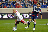Luke Rodgers (9) of the New York Red Bulls is fouled in the penalty box by Heath Pearce (3) of CD Chivas USA. CD Chivas USA defeated the New York Red Bulls 3-2 during a Major League Soccer (MLS) match at Red Bull Arena in Harrison, NJ, on May 15, 2011.