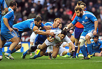 Brad Barritt is tackled to ground. RBS Six Nations match between England and Italy on March 10, 2013 at Twickenham Stadium in London, England. Photo by: Patrick Khachfe / Onside Images