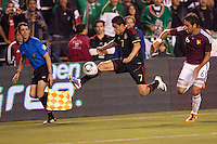 Pablo Barrera (7) forward for Mexico moves past Venezuela defender Gabriel Cichero (6). The national teams of Mexico and Venezuela played to a 1-1 draw in an International friendly match at  Qualcomm stadium in San Diego, California on  March 29, 2011...