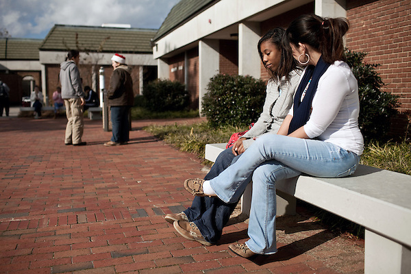 December 09, 2009. Pinehurst, North Carolina.. Students in the SandHoke Early College High School attend classes at Sandhills Community College for their last year of high school and will graduate with a high school diploma, as well as an associates degree.. (right to left) Sharon Aguero and Precious Holt sit outside their classroom on a break during their biology class.