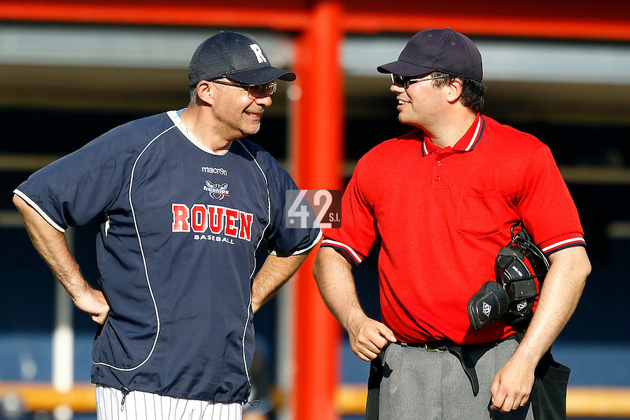15 July 2011: Coach Francois Colombier of the Rouen Huskies talks to umpire Nicolas Roux during the 2011 Challenge de France match won 6-5 by the Rouen Huskies over the Senart Templiers at Stade Pierre Rolland, in Rouen, France.