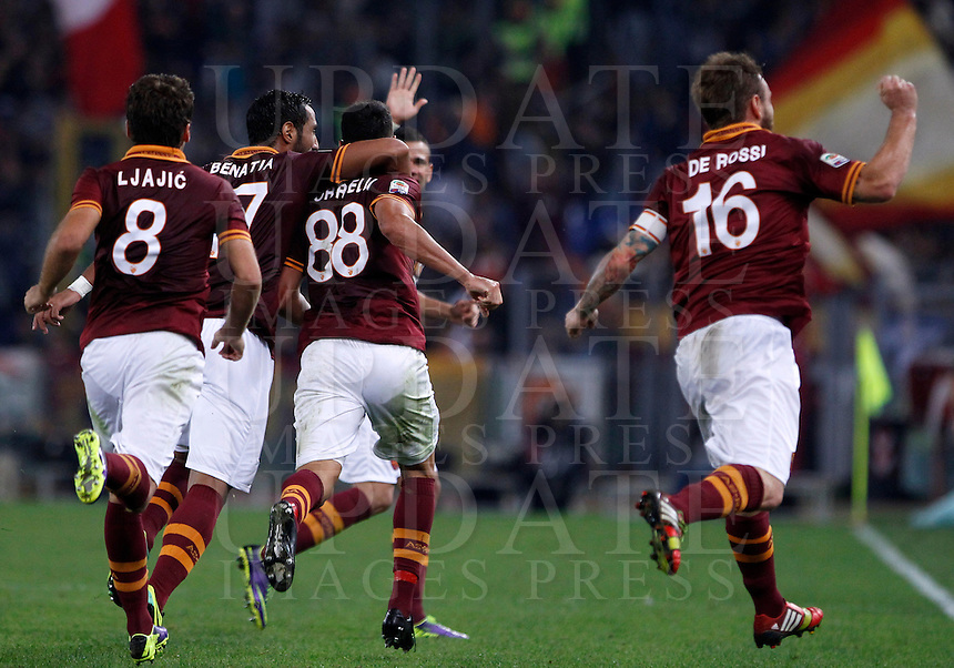 Calcio, Serie A: Roma vs ChievoVerona. Roma, stadio Olimpico, 31 ottobre 2013.<br /> AS Roma forward Marco Borriello, third from left, celebrates with teammates after scoring during the Italian Serie A football match between AS Roma and ChievoVerona at Rome's Olympic stadium, 31 October 2013.<br /> UPDATE IMAGES PRESS/Isabella Bonotto