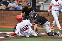 Bristol Pirates catcher Jason Delay (14) tags out Jonathan Rivera (52) as home plate umpire Josh Gilreath prepares to make a call during a game against the Johnson City Cardinals at TVA Credit Union Ballpark on June 23, 2017 in Johnson City, Tennessee. The Pirates defeated the Cardinals 4-3. (Tony Farlow/Four Seam Images)