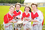 Andrew Shaw, Robin Porter, Marie McDonnell and James Mcdonnell at the hurling Cul Camp at Na Gaeil GAA Club on Friday.