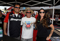 Jul. 26, 2013; Sonoma, CA, USA: A fan gets a picture taken with NHRA funny car drivers Cruz Pedregon and Alexis DeJoria during qualifying for the Sonoma Nationals at Sonoma Raceway. Mandatory Credit: Mark J. Rebilas-