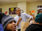 United States President Barack Obama packs and gives bags of food to area residents at Martha's Table on Wednesday, November 24, 2010, in Washington, DC.  .Credit: Leslie E. Kossoff - Pool via CNP