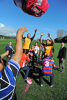 Blake Hill (Thames Valley) and Lemi Masoe (North Otago) go up for lineout bale as Sir Colin Meads (left) and Sir Brian Lochore (right) look on during the Pink Batts Heartland Championship 2013 season launch at Waikanae RFC, Waikanae, New Zealand on Tuesday, 13 August 2013. Photo: Dave Lintott / lintottphoto.co.nz