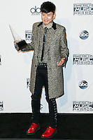 LOS ANGELES, CA, USA - NOVEMBER 23: Jason Zhang Jie poses in the press room at the 2014 American Music Awards held at Nokia Theatre L.A. Live on November 23, 2014 in Los Angeles, California, United States. (Photo by Xavier Collin/Celebrity Monitor)