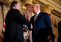 United States President Donald Trump greets Mike Pompeo, U.S. secretary of state, before he is sworn in, at the State Department, in Washington, D.C., U.S., on Wednesday, May 2, 2018. <br /> Credit: Al Drago / Pool via CNP /MediaPunch