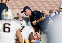 California head coach Jeff Tedford blows a whistle during warm-ups before the game against UCLA at Rose Bowl in Pasadena, California on October 29th, 2011.  UCLA defeated California, 31-14.