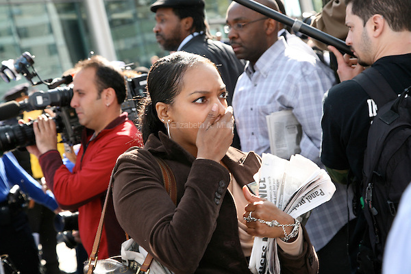 "A woman shows her horror outside Queens Supreme Court after hearing the ""not guilty"" verdict on the three policemen who shot Sean Bell fifty times as he left a Queens strip club."