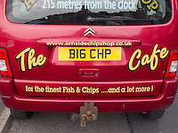 "The ""Big Chip"", Arnside Chip Shop's van with personalised number plate advertising the shop, Arnside, Lancashire, UK"