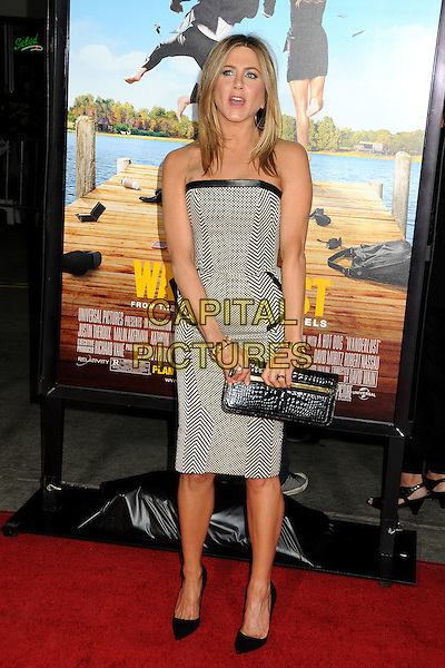 """Jennifer Aniston.""""Wanderlust"""" Los Angeles Premiere held at the Regency Village Theatre, Westwood, California, USA..February 16th, 2012.full length dress peplum mouth open clutch bag black leather strapless white zig zag print check   .CAP/ADM/BP.©Byron Purvis/AdMedia/Capital Pictures."""