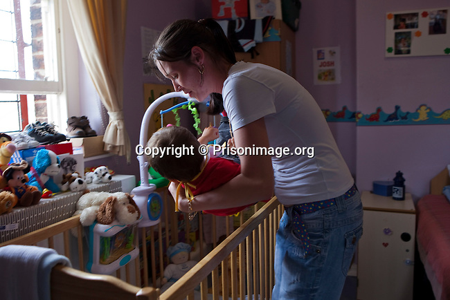 One of the prisoners with her baby in the special mother and baby unit. HMP Styal, Wilmslow, Cheshire
