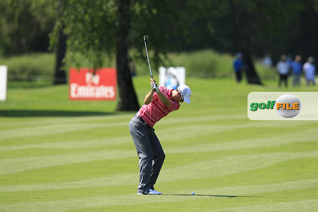 Ross Fisher (ENG) plays his 2nd shot on the 3rd hole during Thursday's Round 1 of the 2013 BMW International Open held on the Eichenried Golf Club, Munich, Germany. 20th June 2013<br /> (Picture: Eoin Clarke www.golffile.ie)