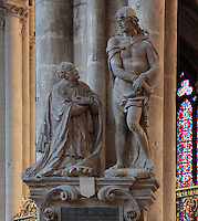 Funerary monument of canon Antoine de Baillon, died 1644, by Nicolas Blasset, 1600-59, with a sculpted group of the canon kneeling in front of a bound Christ, in the nave of the Basilique Cathedrale Notre-Dame d'Amiens or Cathedral Basilica of Our Lady of Amiens, built 1220-70 in Gothic style, Amiens, Picardy, France. Amiens Cathedral was listed as a UNESCO World Heritage Site in 1981. Picture by Manuel Cohen