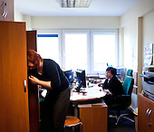 WARSAW, POLAND, FEBRUARY 2012:.Magda, left, who commutes from Skierniewice, working at the office in Warsaw. About 500 thousand people commute everyday from other towns and villages to work in the Polish capital..(Photo by Piotr Malecki / Napo Images)..Warszawa, Luty 2012:.Magda (po lewej), która dojezdza ze Skierniewic w pracy w Warszawie..Okolo 500 tysiecy osob dojezdza codziennie z innych miast do pracy w Warszawie.  .Fot: Piotr Malecki / Napo Images..
