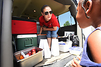 NWA Democrat-Gazette/FLIP PUTTHOFF <br />Katrina Cross hands out lunches to children Tuesday July 3 2018 for First United Methodist Church of Bentonville. The church delivers free lunches to youngsters at four sites in the Bentonville school district in a program started this summer.