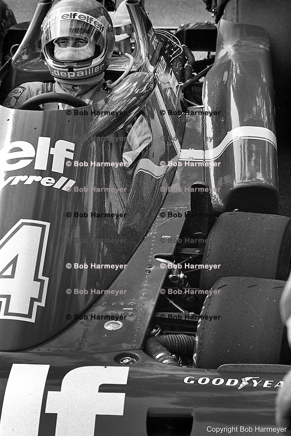 Patrick Depailler waits to drive the Tyrrell P34 Formula 1 car during practice for the 1976 Monaco Grand Prix.