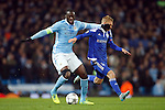 Yaya Toure of Manchester City battles Kiev?s Vitaliy Buyalskyi during the UEFA Champions League match at the Etihad Stadium. Photo credit should read: Philip Oldham/Sportimage