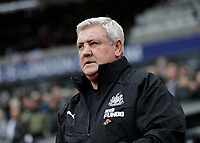 2nd November 2019; London Stadium, London, England; English Premier League Football, West Ham United versus Newcastle United; Newcastle United Manager Steve Bruce looks on from the dugout before kick off - Strictly Editorial Use Only. No use with unauthorized audio, video, data, fixture lists, club/league logos or 'live' services. Online in-match use limited to 120 images, no video emulation. No use in betting, games or single club/league/player publications