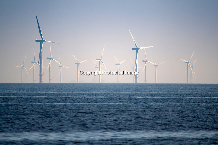 15/05/19<br /> <br /> As summer temperatures continue to rise a light breeze keeps wind turbines turning off the north wales coast near Colwyn Bay.<br /> <br /> Gwynt y Môr is a 576-megawatt offshore wind farm located off the coast of North Wales and is the fourth largest operating offshore windfarm in the world. The farm has 160 wind turbines of 150 metres tip height above mean sea level. <br /> <br /> All Rights Reserved, F Stop Press Ltd +44 (0)7765 242650  www.fstoppress.com rod@fstoppress.com