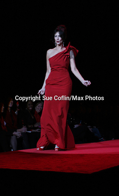 Lynda Carter wearing Carolina Herrera walks the runway at The Heart Truth's Red Dress Collection 2009 Fashion Show which raises awareness that heart disease is the #1 killer of women was held during Mercedes -Benz Fashion Week New York Fall 09 on February 13, 2009 in Bryant Park, New York City, NY. This event unites with America's top designers to showcase a colleciton of one-of-a-kind Red Dresses. (Photo by Sue Coflin/Max Photos)