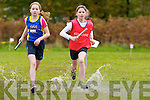 Eleanor Dennison Kenmare leads Shona O'Brien Spa/Muckross through the puddles during the u13 relay race in Killarney on Sunday..