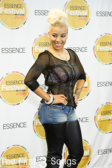 Keyshia Cole poses for the press at the 2013 Essence Festival at the Mercedes-Benz Superdome in New Orleans, Louisiana.