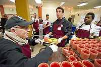 San Francisco, California - January 7, 2010: Kraft Fight Hunger Bowl players from Nevada and Boston College serve meals in San Francisco, California.