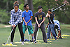 Jasmine Arroyo, 14, of Lawrence, practices her swing alongside fellow golf students Deven Rampersaud, 13, of North Woodmere, second from left, and Carson Libbey, 13, of Atlantic Beach at Lawrence Yacht and Country Club on Tuesday, June 7, 2016.