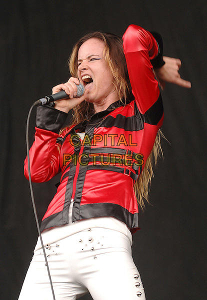 JULIETTE LEWIS & THE LICKS.Performing live at the V Festival, Hylands Park, Chelmsford, England..August 18th, 2007.stage concert live gig performance music half length red black leather jacket  microphone singing white trousers .CAP/BEL.©Belcher/Capital Pictures