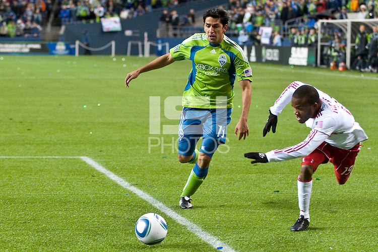 Leo Gonzalez (l) fights for the ball against Dane Richards (19) as the Seattle Sounders lost to the New York Red Bulls, 1-0, in an MLS match on Saturday, April 3, 2010 at Qwest Field in Seattle, WA.