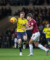 Johnny Mullins of Oxford United & Marc Richards of Northampton Town in action during the Sky Bet League 2 match between Oxford United and Northampton Town at the Kassam Stadium, Oxford, England on 16 February 2016. Photo by Andy Rowland.