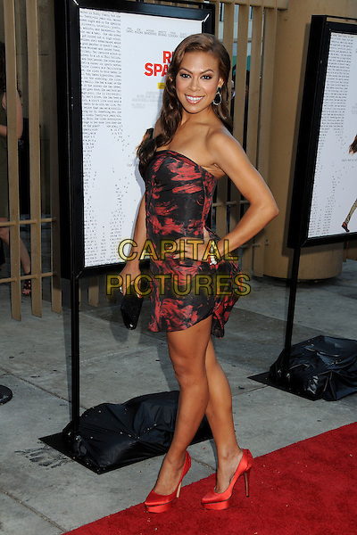 Toni Trucks.'Ruby Sparks' Los Angeles Premiere held at the Egyptian Theatre, Hollywood, California, USA 19th July 2012..full length strapless red black dress print hand on hip shoes platform .CAP/ADM/BP.©Byron Purvis/AdMedia/Capital Pictures.