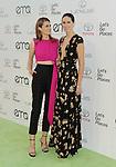 BURBANK, CA- OCTOBER 18: Actress Stana Katic (L) and sister Gigi Katic arrive at the 2014 Environmental Media Awards at Warner Bros. Studios on October 18, 2014 in Burbank, California.