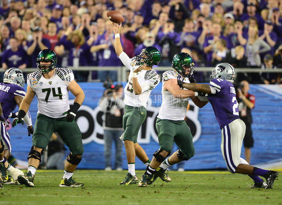Jan. 3, 2013; Glendale, AZ, USA: Oregon Ducks quarterback Marcus Mariota (8) throws a pass in the second quarter against the Kansas State Wildcats during the 2013 Fiesta Bowl at University of Phoenix Stadium. Mandatory Credit: Mark J. Rebilas-