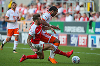 Rotherham United's Joe Mattock goes through the back of Blackpool's Nathan Delfouneso<br /> <br /> Photographer Alex Dodd/CameraSport<br /> <br /> The EFL Sky Bet League One - Rotherham United v Blackpool - Saturday 5th May 2018 - New York Stadium - Rotherham<br /> <br /> World Copyright &copy; 2018 CameraSport. All rights reserved. 43 Linden Ave. Countesthorpe. Leicester. England. LE8 5PG - Tel: +44 (0) 116 277 4147 - admin@camerasport.com - www.camerasport.com