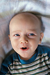 Berkeley, CA Baby boy six months old happily cooing  MR