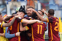 Calcio, Serie A: Lazio vs Roma. Roma, stadio Olimpico, 3 aprile 2016.<br /> Roma's Edin Dzeko, left, celebrates with teammates after scoring during the Italian Serie A football match between Lazio and Roma at Rome's Olympic stadium, 3 April 2016.<br /> UPDATE IMAGES PRESS/Riccardo De Luca