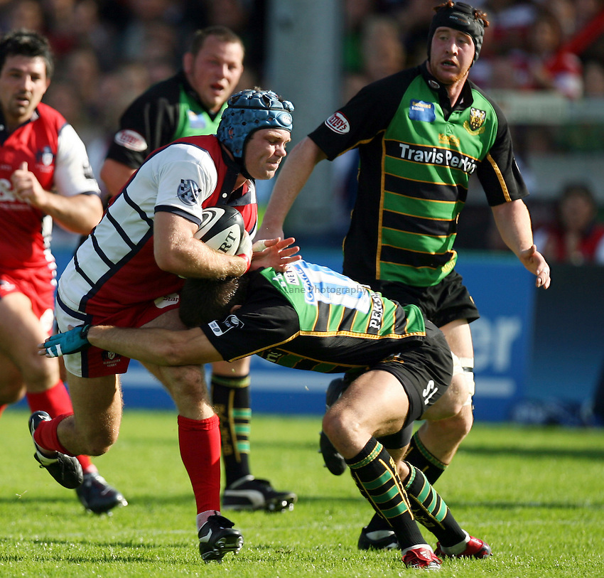 Photo: Rich Eaton.....Gloucester Rugby v Northampton Saints. Guinness Premiership. 23/09/2006. Gloucester's Andy Hazell in is tackled.