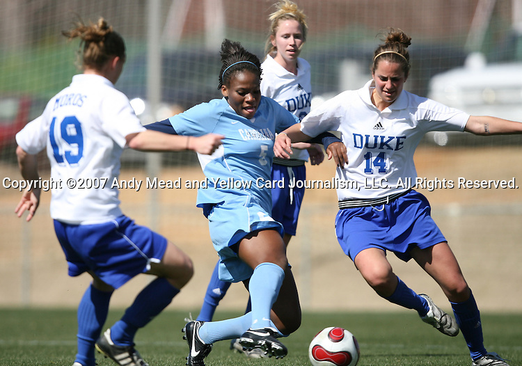 North Carolina's Jaime Gilbert (5) and Duke's Christie McDonald (14) challenge for the ball on Saturday, March 3rd, 2007 on Field 1 at SAS Soccer Park in Cary, North Carolina. The Duke University Blue Devils played the University of North Carolina Tarheels in an NCAA Division I Women's Soccer spring game.