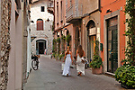 Street with cafes and shops in downtown Como, Italy a town on Lake Como