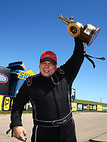 May 21, 2017; Topeka, KS, USA; NHRA top alcohol dragster driver Shawn Cowie celebrates after winning the Heartland Nationals at Heartland Park Topeka. Mandatory Credit: Mark J. Rebilas-USA TODAY Sports